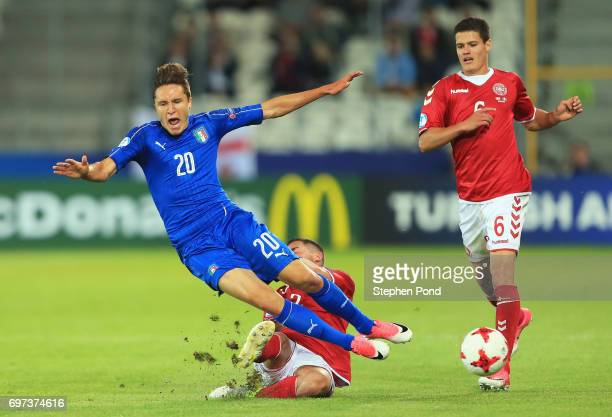 Federico Chiesa of Italy is fouled by Frederik Holst of Denmark during the UEFA European Under21 Championship Group C match between Denmark and Italy...