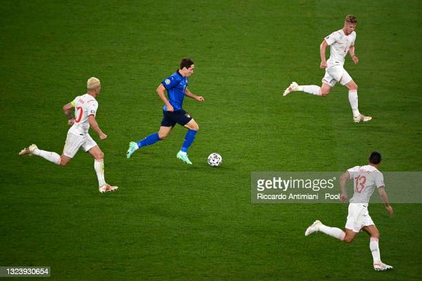 Federico Chiesa of Italy makes a break during the UEFA Euro 2020 Championship Group A match between Italy and Switzerland at Olimpico Stadium on June...