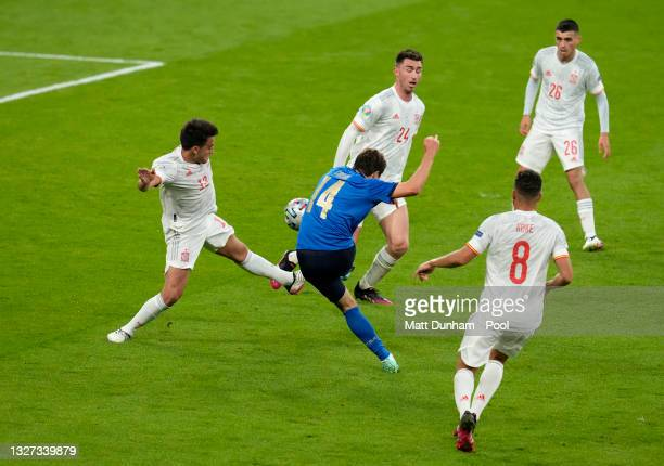 Federico Chiesa of Italy scores their team's first goal whilst under pressure from Eric Garcia of Spain during the UEFA Euro 2020 Championship...