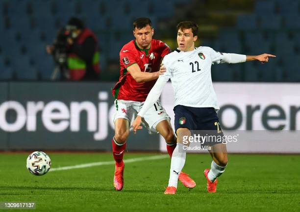 Federico Chiesa of Itlay competes for the ball with Vasil Bozhikov of Bulgaria during the FIFA World Cup 2022 Qatar qualifying match between Bulgaria...