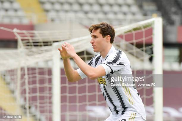 Federico Chiesa of Juventus celebrates after scoring his team's first goal during the Serie A match between Torino FC and Juventus at Stadio Olimpico...