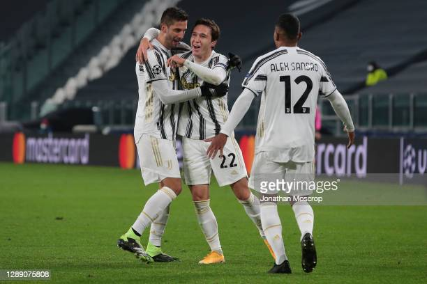Federico Chiesa of Juventus celebrates with team mate Rodrigo Bentancur after heading the side into a 1-0 lead during the UEFA Champions League Group...