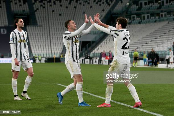 Federico Chiesa of Juventus celebrates with team mates after scoring to give the side a 2-0 lead during the Serie A match between Juventus and Spezia...