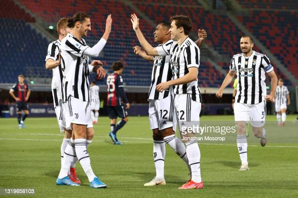 Federico Chiesa of Juventus celebrates with team mates after scoring to give the side a 1-0 lead during the Serie A match between Bologna FC and...
