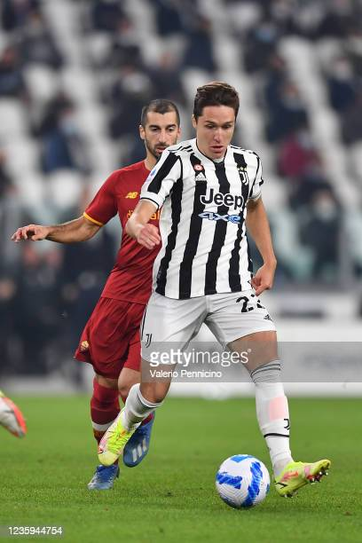 Federico Chiesa of Juventus in action against Henrikh Mkhitaryan of AS Roma during the Serie A match between Juventus and AS Roma at on October 17,...