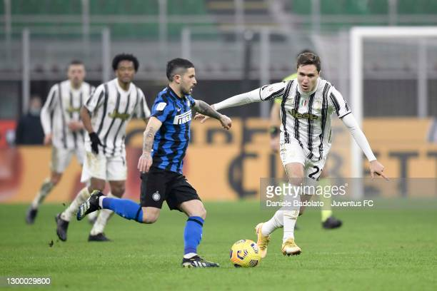 Federico Chiesa of Juventus is challenged by Stefano Sensi of FC Internazionale during the Coppa Italia semi-final match between FC Internazionale...