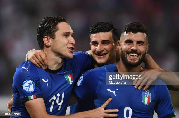 Federico Chiesa Riccardo Orsolini and Patrick Cutrone of Italy celebrate at the end of the 2019 UEFA U21 Group A match between Italy and Spain at...