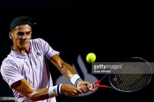Federico Coria of Argentina returns a shot to Carlos Alcaraz of Spain during the ATP Rio Open 2020 at Jockey Club Brasileiro on February 19 2020 in...