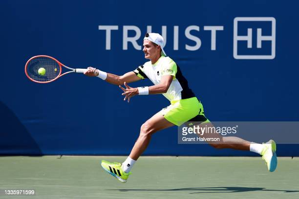 Federico Coria of Argentina returns a shot to Lorenzo Musetti of Italy during the Winston-Salem Open at Wake Forest Tennis Complex on August 23, 2021...