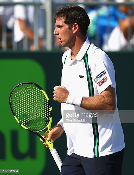 Federico Delbonis of Argentina celebrates a point against Grigor Dimitrov of Bulgaria in their second round match during the Miami Open Presented by...