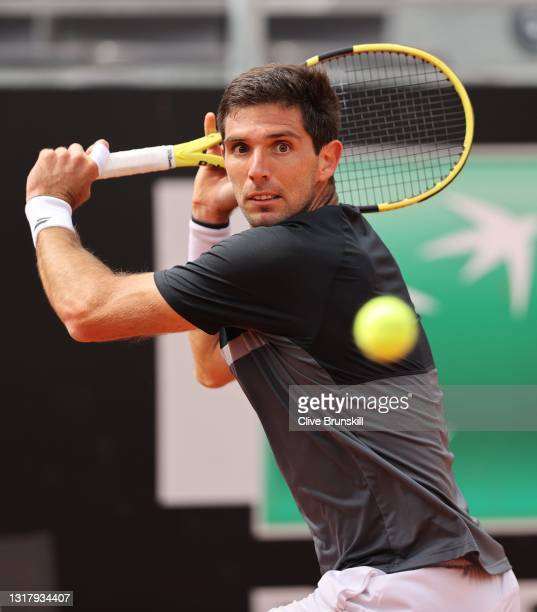 Federico Delbonis of Argentina hits a backhand to Reilly Opelka of the USA during their match on Day Seven of the Internazionali BNL D'Italia at Foro...