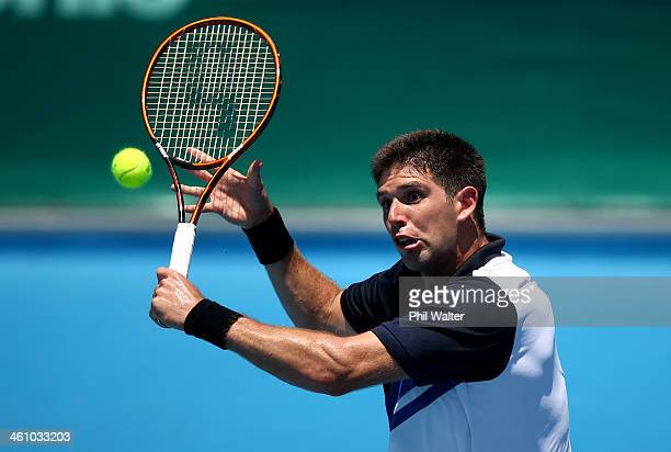 Federico Delbonis of Argentina plays a backhand during his first round match against Donald Young of the USA during day two of the Heineken Open at...
