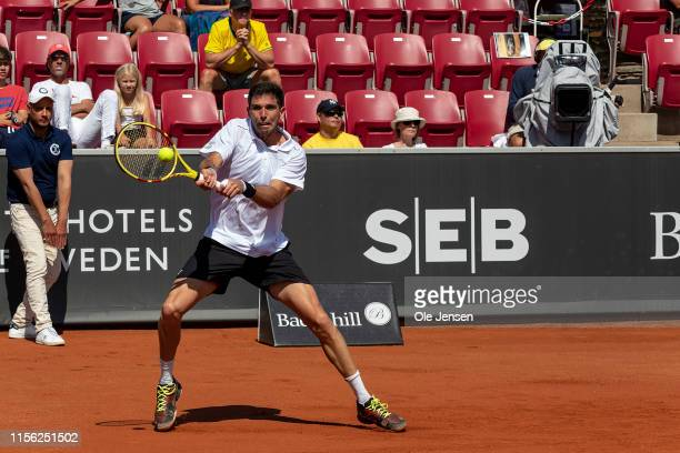 Federico Delbonis of Argentina plays a backhand during his match against Pablo Cuevas of Uruguay during the FTA singles tournament at the 2019...