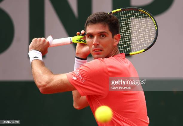 Federico Delbonis of Argentina plays a backhand during the mens singles second round match against Pablo Carreno Busta of Spain during day four of...