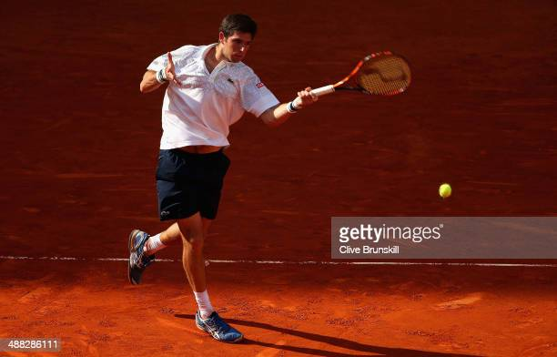 Federico Delbonis of Argentina plays a forehand against Feliciano Lopez of Spain in their first round match during day three of the Mutua Madrid Open...