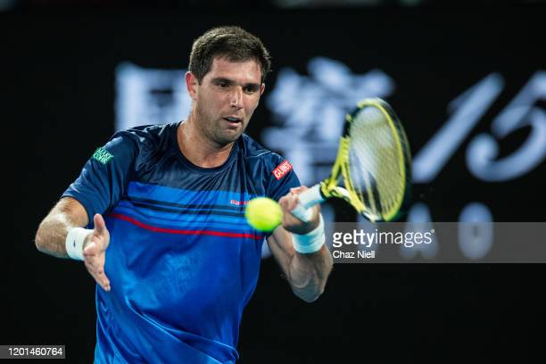 Federico Delbonis of Argentina plays a forehand in his second round match against Rafeal Nadal of Spain on day four of the 2020 Australian Open at...