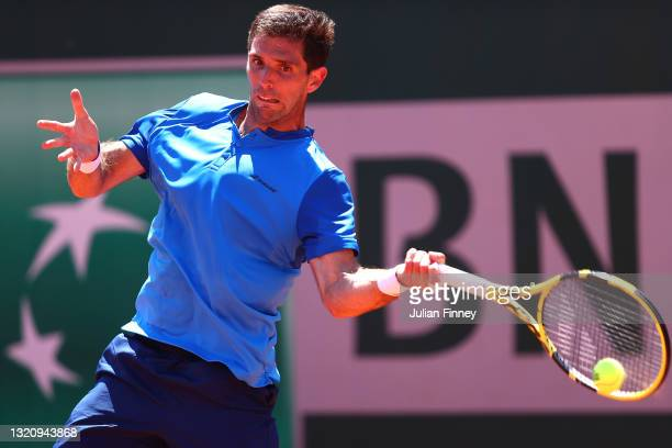 Federico Delbonis of Argentina plays a forehand in their mens singles first round match against Radu Albot of Albania on day two of the 2021 French...