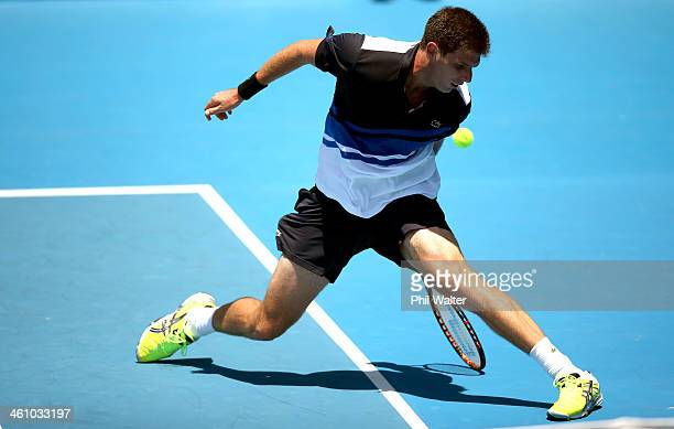 Federico Delbonis of Argentina plays a shot between his legs during his first round match against Donald Young of the USA during day two of the...