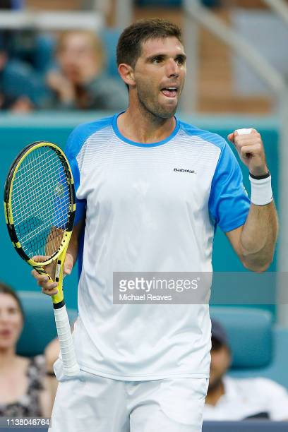 Federico Delbonis of Argentina reacts during his match against Novak Djokovic of Serbia during Day 7 of the Miami Open Presented by Itau at Hard Rock...