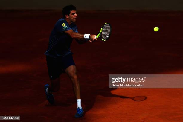 Federico Delbonis of Argentina returns a backhand in his match against Albert RamosVinolas of Spain during day two of the Internazionali BNL d'Italia...