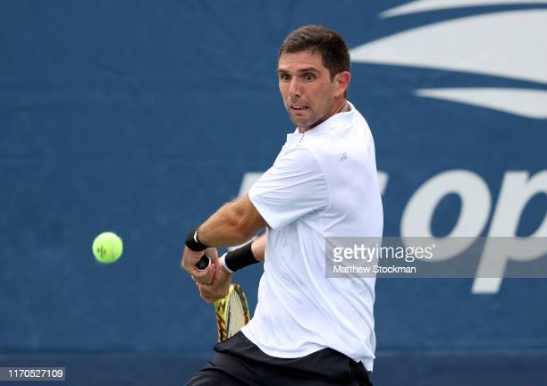 Federico Delbonis of Argentina returns a shot against Alexei Popyrin of Australia during their Men's Singles first round match on day two of the 2019...