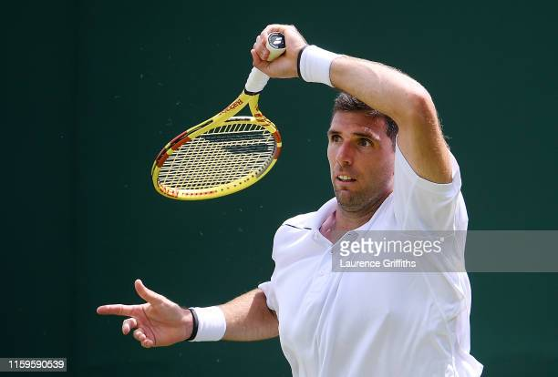 Federico Delbonis of Argentina returns a shot in his Men's Singles first round match against Daniel Evans of Great Britain during Day two of The...