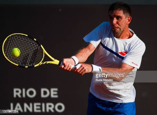 Federico Delbonis of Argentina returns a shot to Cristian Garin of Chile during the ATP Rio Open 2020 at Jockey Club Brasileiro on February 19, 2020...