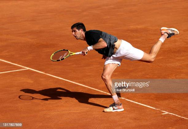 Federico Delbonis of Argentina serves in their mens singles third round match against Felix Auger-Aliassime of Canada during Day Six of the...