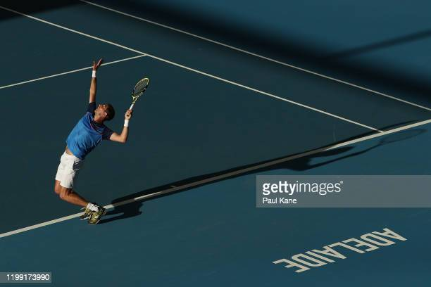 Federico Delbonis of Argentina serves to James Duckworth of Australia during day two of the 2020 Adelaide International at Memorial Drive on January...