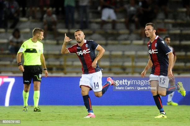 Federico Di Francesco 14 of Bologna FC celebrates after scoring the opening goal during the Serie A match between Bologna FC and Torino FC at Stadio...