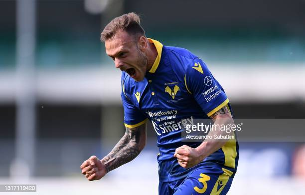 Federico Dimarco of Hellas Verona celebrates after scoring the 1-1 goal during the Serie A match between Hellas Verona FC and Torino FC at Stadio...
