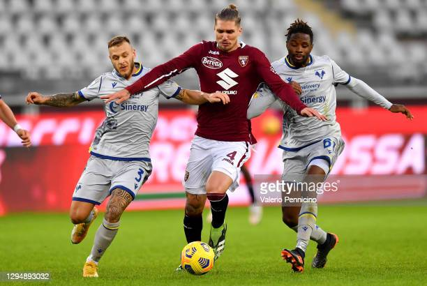 Federico Dimarco of Hellas Verona F.C. And Adrien Tameze of Hellas Verona F.C. Battles for possession with Lyanco of Torino F.C. During the Serie A...