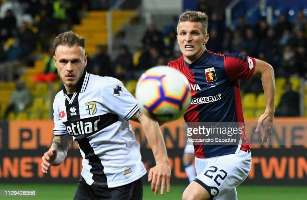 Federico Dimarco of Parma Calcio competes for the ball with Darko Lazovic of Genoa CFCduring the Serie A match between Parma Calcio and Genoa CFC at...