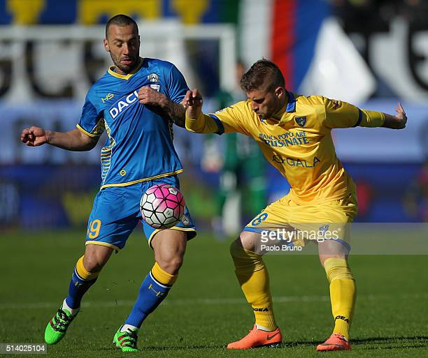 Federico Dionisi of Frosinone Calcio competes for the ball with Dos Santos Torres Guilherme of Udinese Calcio during the Serie A match between...