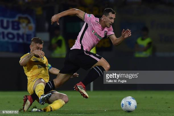Federico Dionisi of Frosinone fouls Mato Jajalo during the serie B playoff match final between Frosinone Calcio v US Citta di Palermo at Stadio...