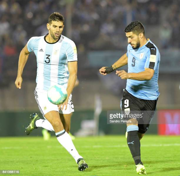 Federico Fazio of Argentina and Luis Suarez of Uruguay fight for the ball during a match between Uruguay and Argentina as part of FIFA 2018 World Cup...