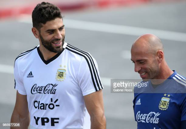 Federico Fazio of Argentina and Wilfredo Caballero of Argentina arrive prior a training session at Stadium of Syroyezhkin sports school on June 27...