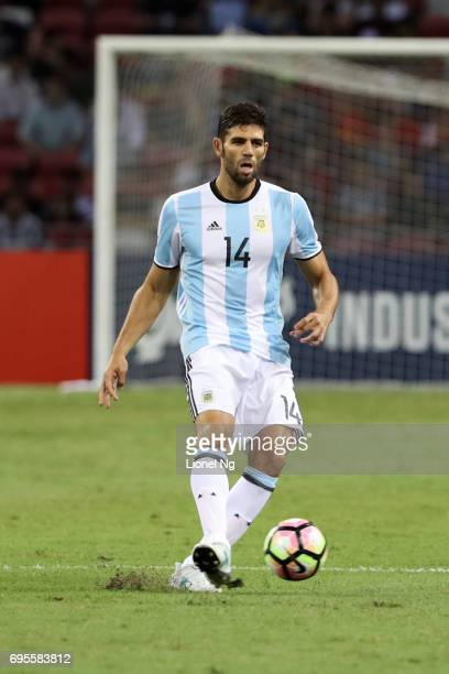 Federico Fazio of Argentina dribbles the ball during the international friendly match between Argentina and Singapore at National Stadium on June 13...