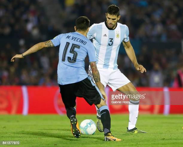 Federico Fazio of Argentina fights for the ball with Matias Vecino of Uruguay during a match between Uruguay and Argentina as part of FIFA 2018 World...