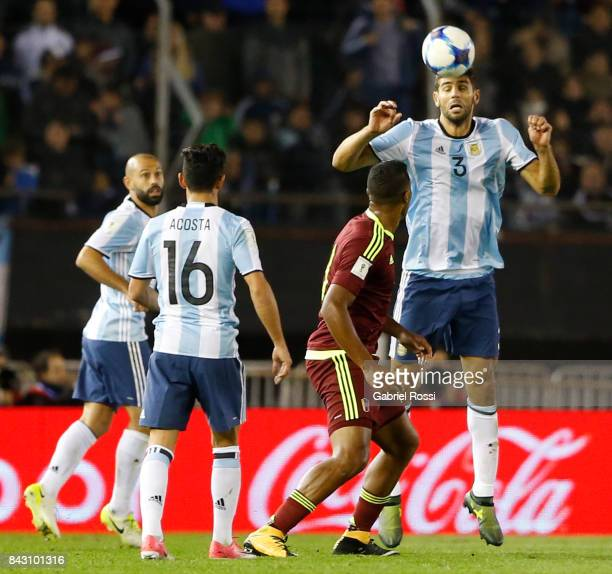 Federico Fazio of Argentina heads the ball during a match between Argentina and Venezuela as part of FIFA 2018 World Cup Qualifiers at Monumental...
