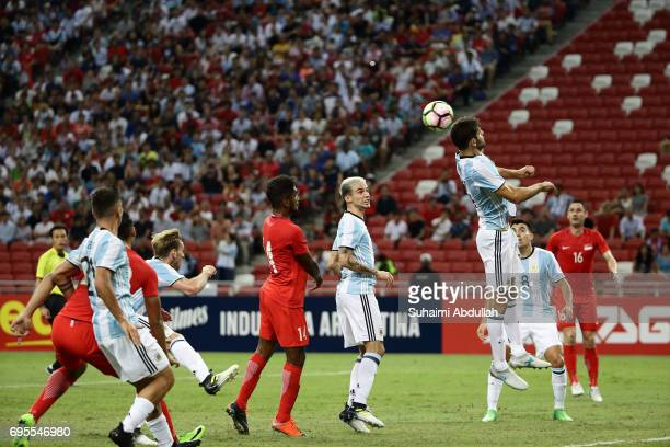 Federico Fazio of Argentina jumps for the ball during the International Test match between Argentina and Singapore at National Stadium on June 13...