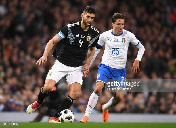 Federico Fazio of Argentina runs with the ball under pressure from Federico Chiesa of Italy during the International friendly match between Italy and...