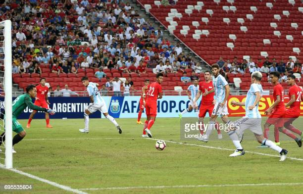 Federico Fazio of Argentina scores the first goal for Argentina during the international friendly match between Argentina and Singapore at National...