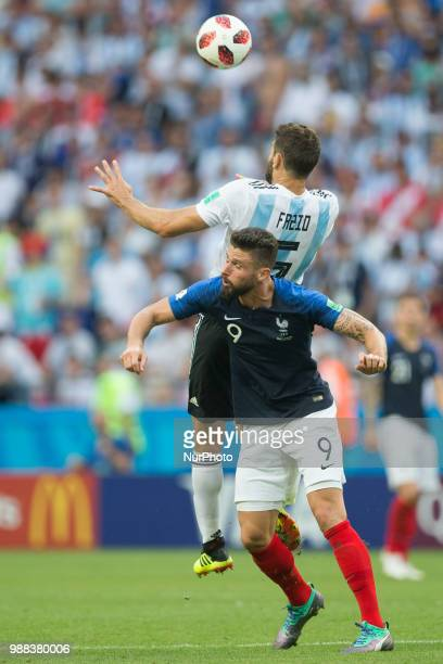 Federico Fazio of Argentina vies Olivier Giroud of France during the 2018 FIFA World Cup Russia Round of 16 match between France and Argentina at...