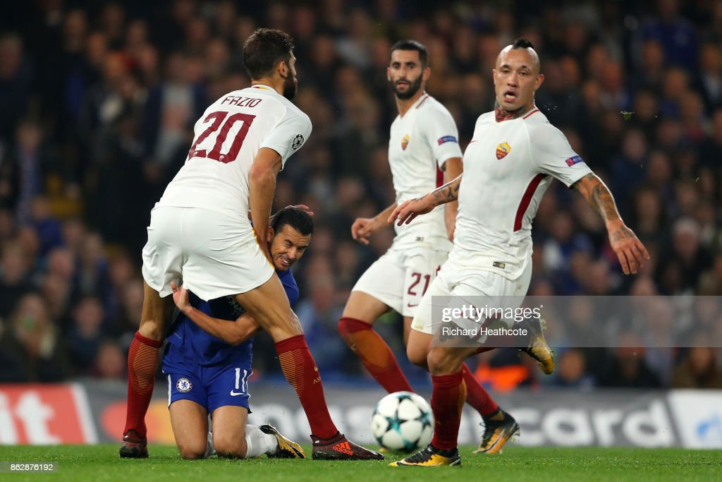 Federico Fazio of AS Roma and Pedro of Chelsea colide during the UEFA Champions League group C match between Chelsea FC and AS Roma at Stamford Bridge on October 18, 2017 in London, United Kingdom.