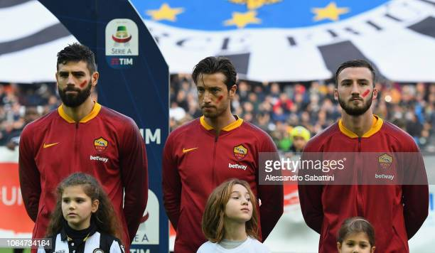 Federico Fazio of AS Roma Antonio Mirante of AS Roma and Bryan Cristante of AS Roma took to the pitch with a red streak on their cheeks as part of a...