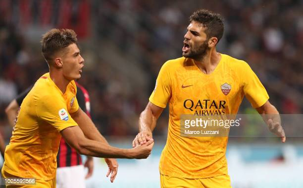 Federico Fazio of AS Roma celebrates after scoring the first goal of his team with teammate Patrick Schick during the serie A match between AC Milan...