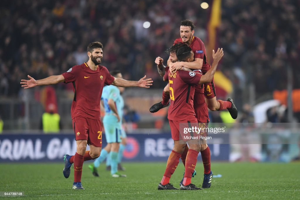 Federico Fazio of AS Roma celebrates his sides victory with team mates Alessandro Florenzi Juan Jesus and Daniele De Rossi after the UEFA Champions League Quarter Final Second Leg match between AS Roma and FC Barcelona at Stadio Olimpico on April 10, 2018 in Rome, Italy.