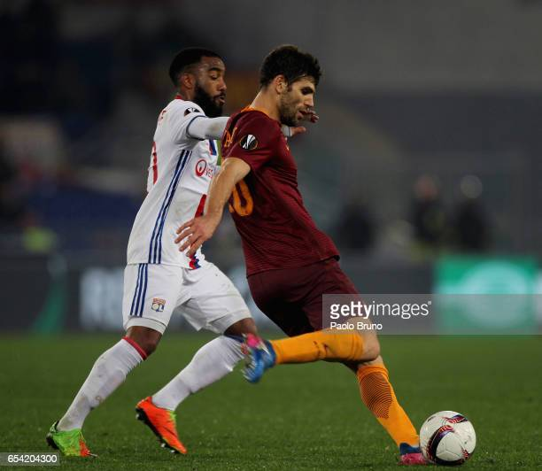 Federico Fazio of AS Roma competes for the ball with Alexandre Lacazette of Olympique Lyonnais during the UEFA Europa League Round of 16 second leg...