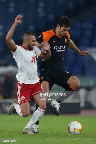 Federico Fazio of AS Roma competes for the ball with Gerorgi Yomov of CSKA-Sofia during the UEFA Europa League Group A stage match between AS Roma...